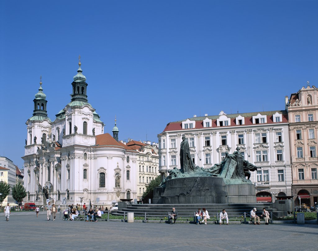 People in front of the Jan Hus Monument and St. Nicholas Church, Old Town Square, Prague, Czech Republic : Stock Photo