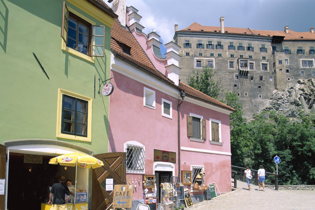 Low angle view of stores and the Castle, Old Town, Cesky Krumlov, South Bohemia, Czech Republic : Stock Photo