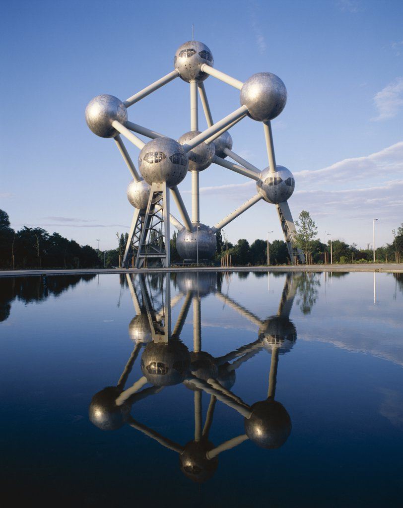 Reflection of a monument in water, Atomium, Brussels, Belgium : Stock Photo