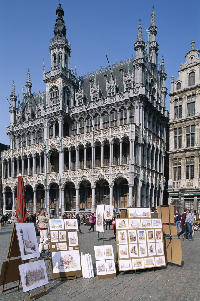 Paintings on display in front of the Town Hall, Grand Place, Brussels, Belgium : Stock Photo
