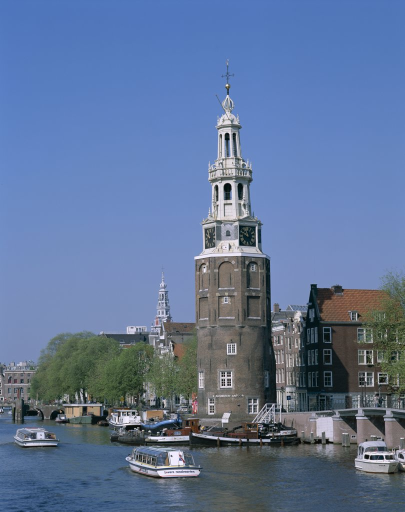 Stock Photo: 442-8871 Montelbaanstoren and Canal Tour Boats, Amsterdam, Netherlands