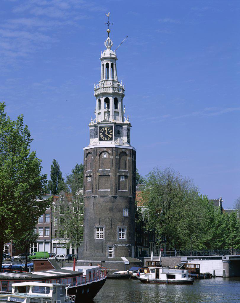 Stock Photo: 442-8874 Montelbaanstoren and Canal Tour Boats, Amsterdam, Netherlands