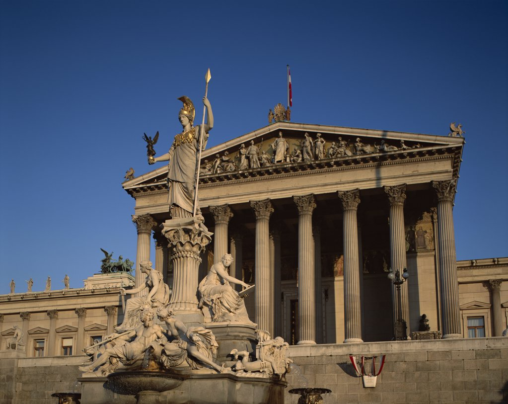 Low angle view of a statue in front of a government building, Parliament Building, Vienna, Austria : Stock Photo