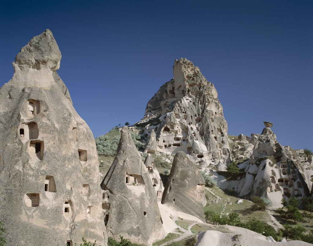 Stock Photo: 442-8998 Low angle view of rock formations, Rock Churches, Goreme Valley, Cappadocia, Turkey