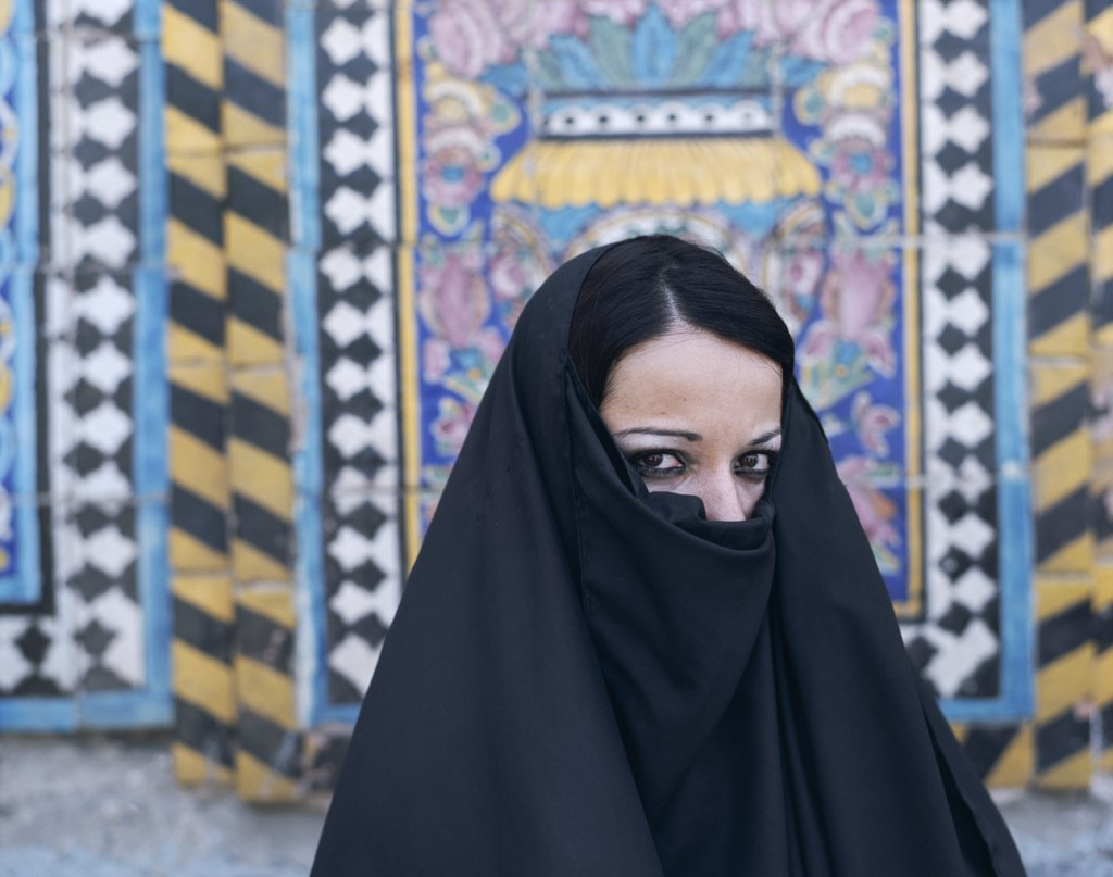 Portrait of a young Muslilm woman wearing a headdress, Iraq : Stock Photo