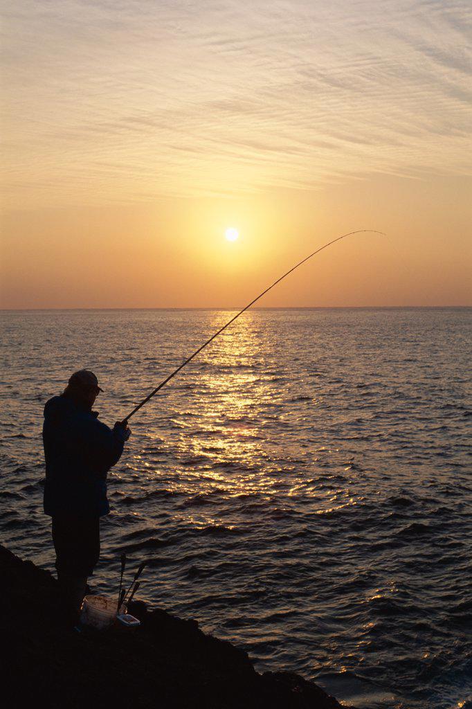 Stock Photo: 442-9097 Silhouette of a fisherman fishing at sunset, Oshima Island, Japan