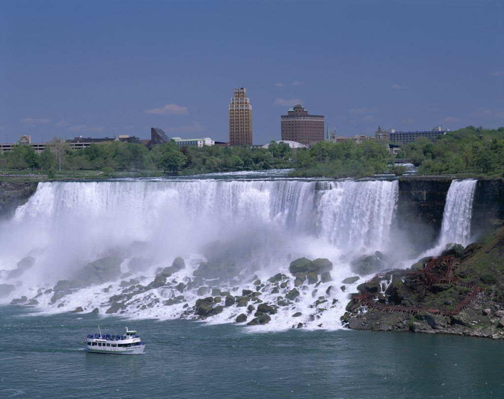 Stock Photo: 442-9125 Tourboat in front of a waterfall, Maid of the Mist Boat Tour, Niagara Falls, Ontario, Canada