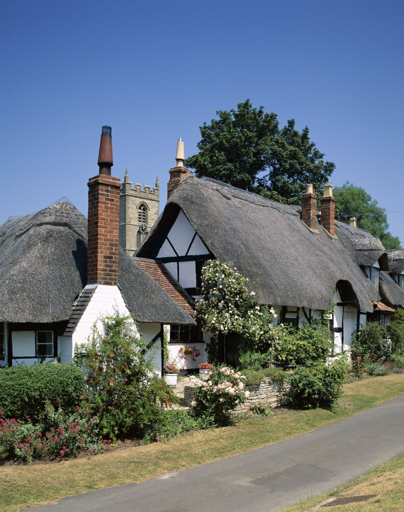 House and church at the side of a road, Welford-on-Avon, England : Stock Photo
