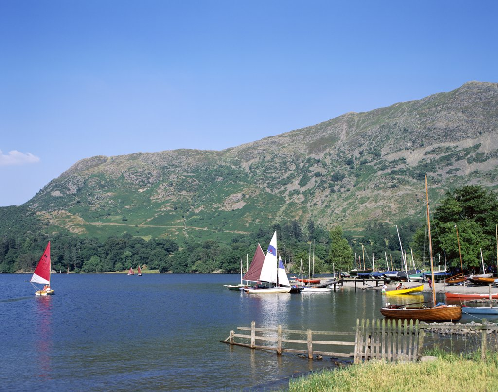 Sailboats on a lake, Ullswater, Lake District, Cumbria, England : Stock Photo
