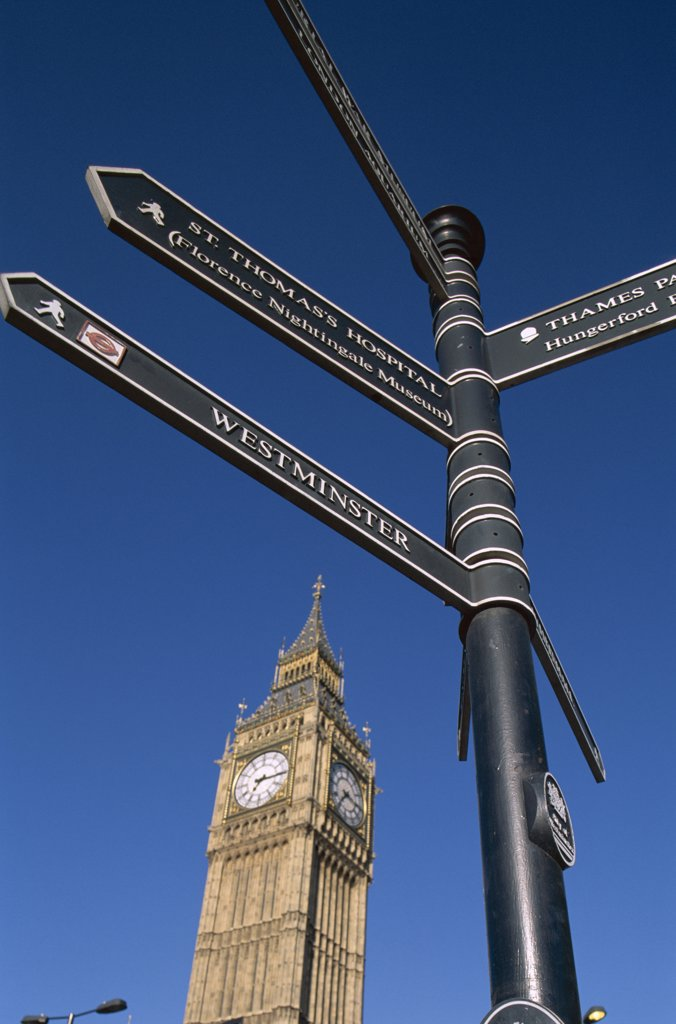 Low angle view of Big Ben and a sign post, London, England : Stock Photo