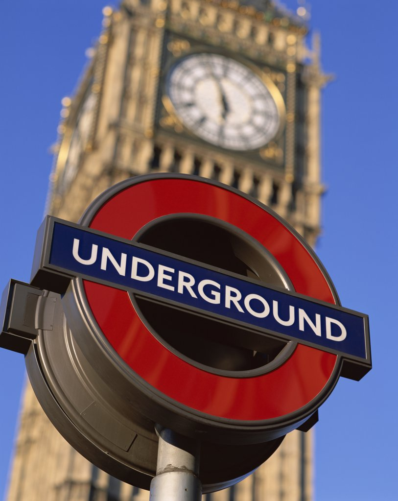 Stock Photo: 442-9485 Low angle view of Underground subway sign in front of Big Ben, London, England