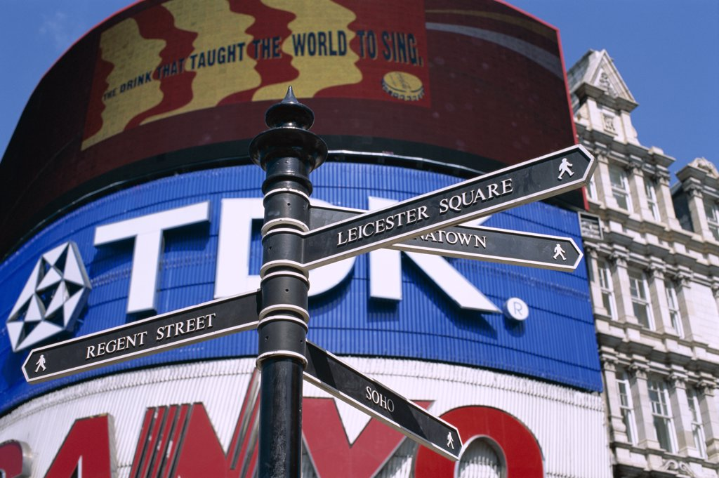 Low angle view of a sign post, Piccadilly Circus, London, England : Stock Photo
