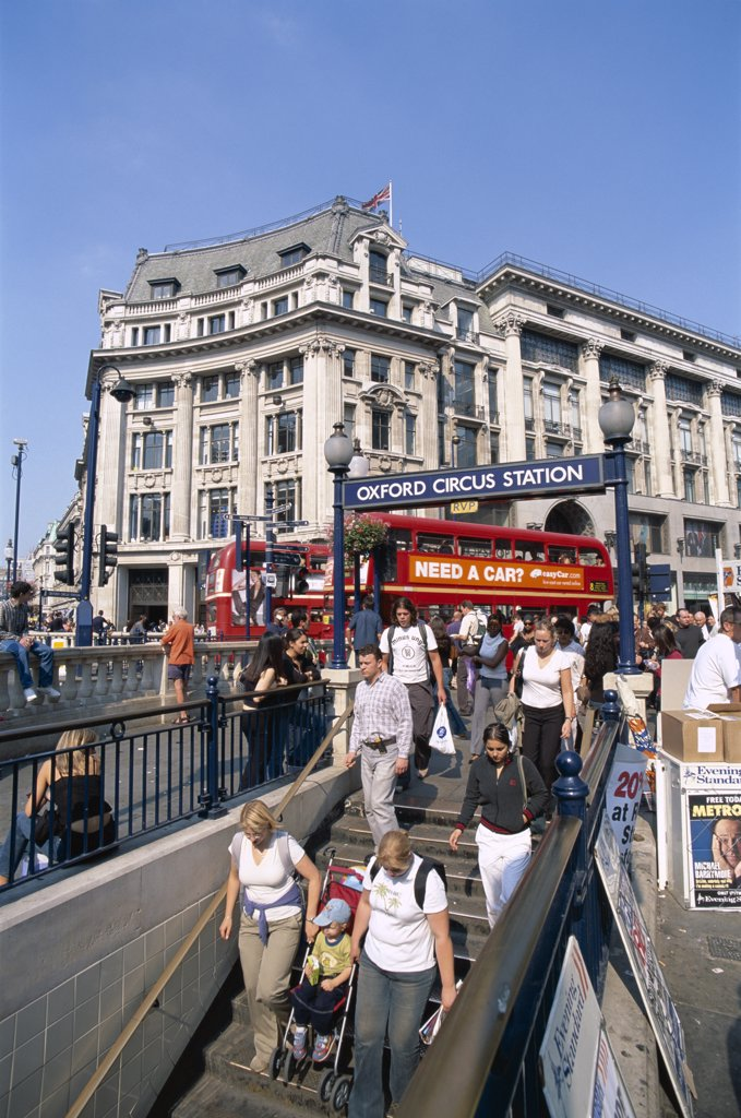 People walking at the underground entrance, Oxford Circus, Oxford Street, London, England : Stock Photo
