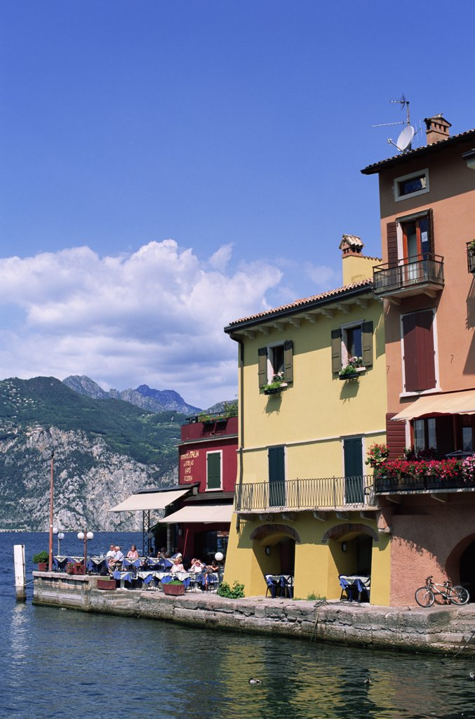 Buildings on the waterfront, Lake Garda, Malcesine, Italy : Stock Photo