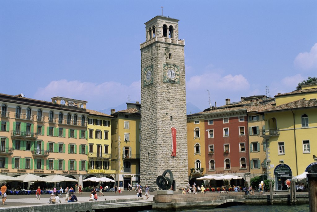 Low angle view of a clock tower in front of buildings, Aponale Tower, Riva del Garda, Italy : Stock Photo