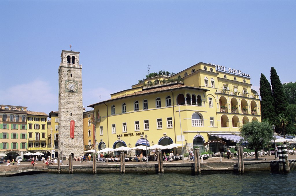 Stock Photo: 442-9887 Clock tower in front of buildings, Aponale Tower, Riva del Garda, Italy