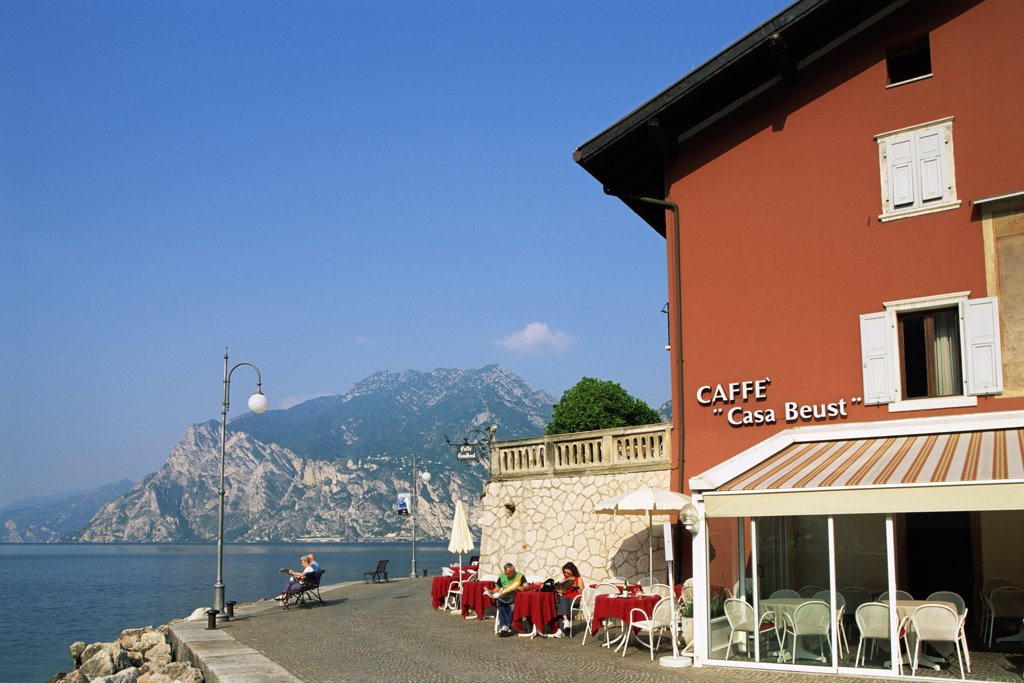 Sidewalk cafe on the waterfront, Lake Garda, Torbole, Lombardy, Italy : Stock Photo