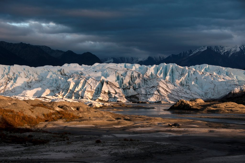 View of valley glacier terminus at sunset, Matanuska Glacier, Chugach Mountains, Alaska, U.S.A., september : Stock Photo