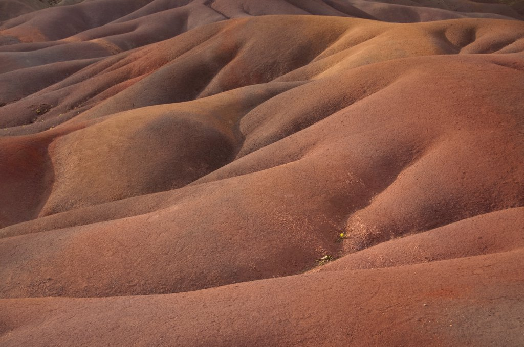 View of sand dunes comprising of different coloured sands, caused by decomposed basalt gullies of ferralitic soil, red colour caused by iron sesquioxydes and blue colour caused by aluminium sesquioxydes, Seven Coloured Earths, Chamarel, Black River District, West Mauritius : Stock Photo