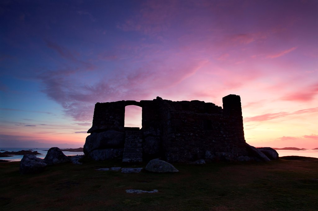 Stock Photo: 4421-34731 16th century fort built to defend harbour silhouetted at sunrise, The Blockhouse, Block Point, between Green Porth and Cook's Porth, Old Grimsby, Tresco, Isles of Scilly, England, september