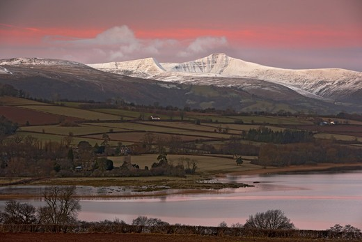Stock Photo: 4421-35046 View of lake, farmland and snow covered hills at dawn, Llangorse Lake, Brecon Beacons N.P., Powys, Wales, january