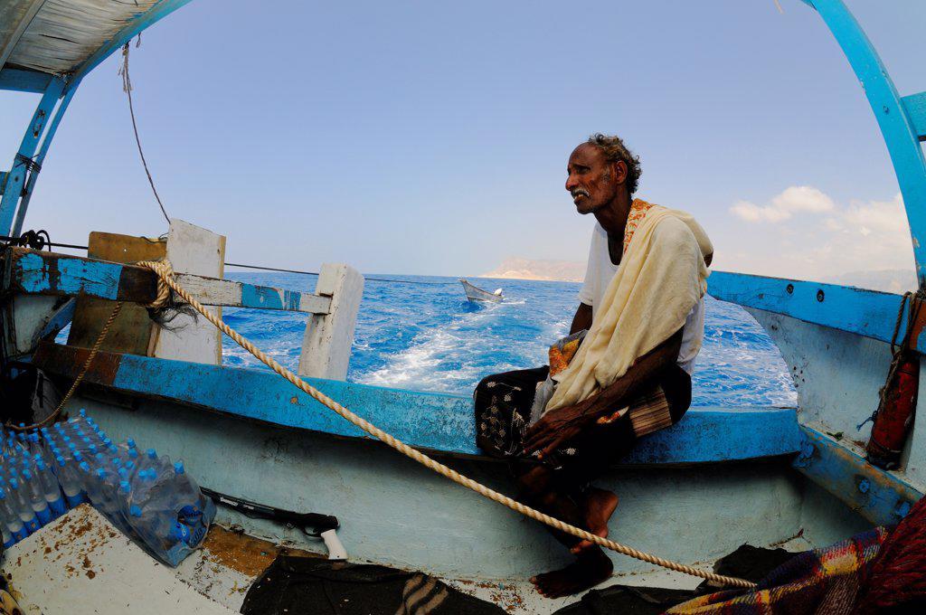 Local fisherman sitting on boat at sea, Socotra, Yemen, march : Stock Photo