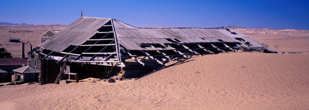 Stock Photo: 4421-35711 Namibia Sand encroaching on buildings of abandon diamond mining town of Kolmanskop, Namibia