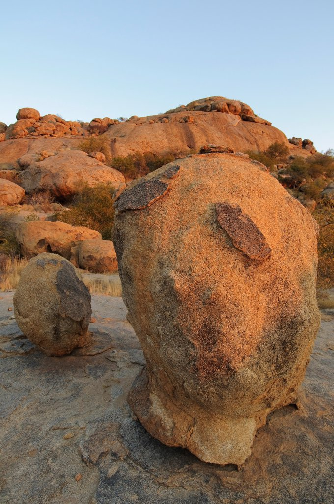 Weathered granite boulders, scattered in desert, Erongo, Namibia : Stock Photo