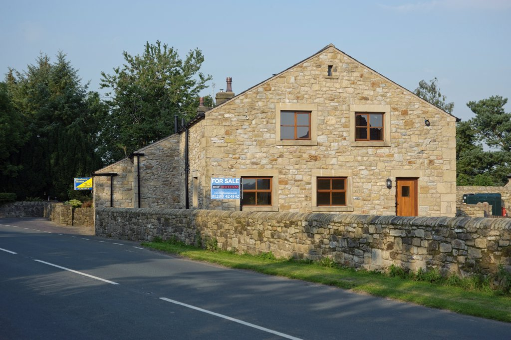 Farm buildings converted into housing, with 'For Sale' signs, Chipping, Lancashire, England, september : Stock Photo