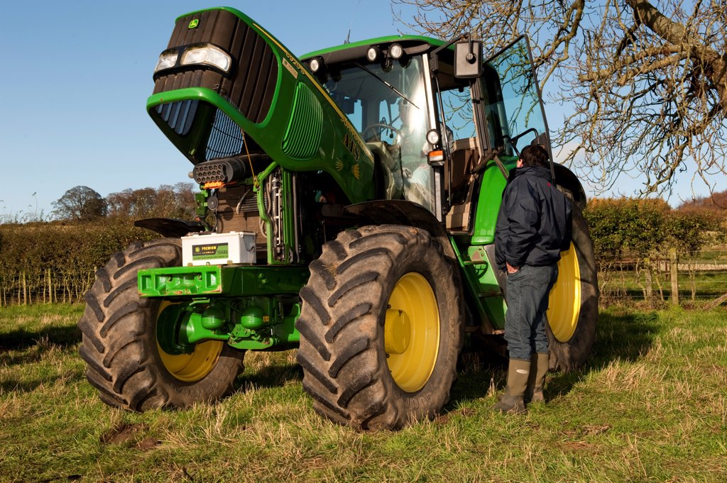 John Deere 6920 S tractor, with bonnet up in field, England : Stock Photo