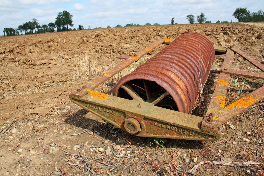 Stock Photo: 4421-40093 Rollers in cultivated arable field, Old Newton, Suffolk, England, august