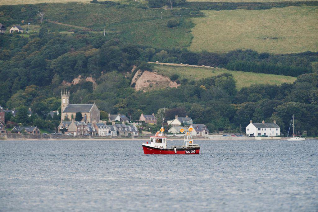 Stock Photo: 4421-40556 Small fishing boat at sea near coastal village, Moray Firth, Scotland