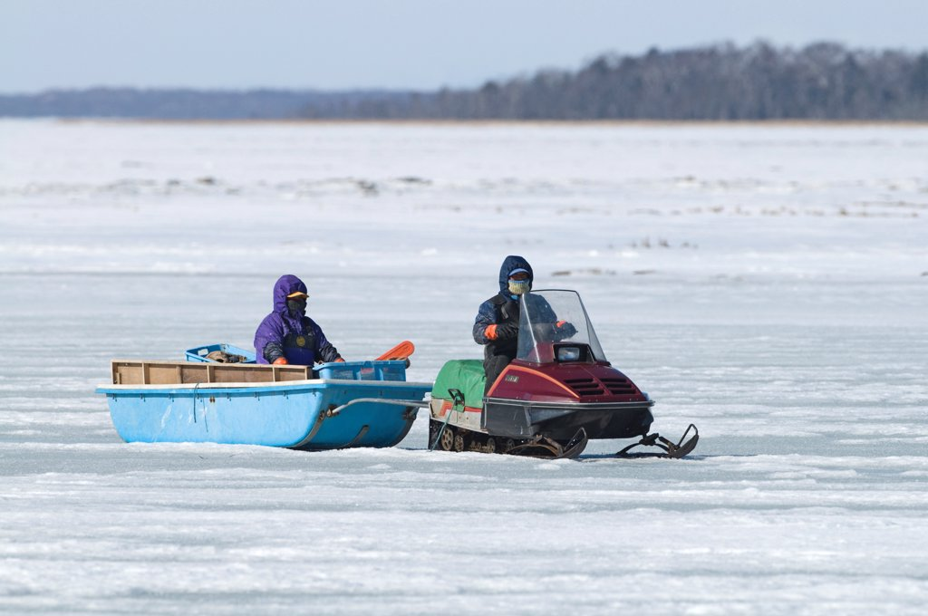 Ice fishermen with skidoo on frozen lake, Lake Fuhren, Hokkaido, Japan, winter : Stock Photo