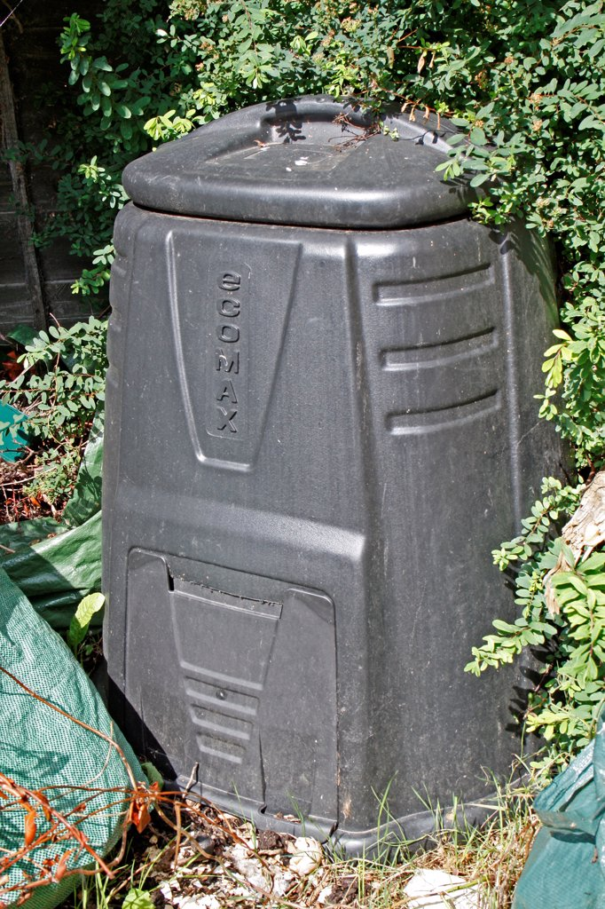 Stock Photo: 4421-40765 Plastic compost bin in garden, Suffolk, England, august