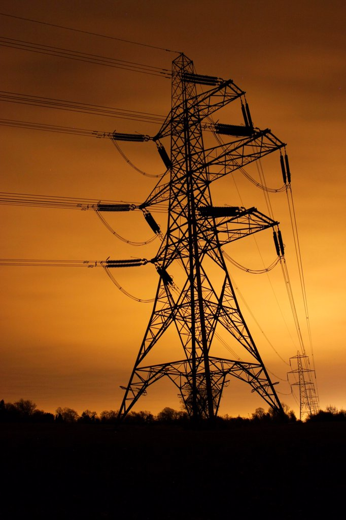 Stock Photo: 4421-41172 Electricity pylon and overhead wires, lit at night by light pollution from city of Leicester, Leicestershire, England