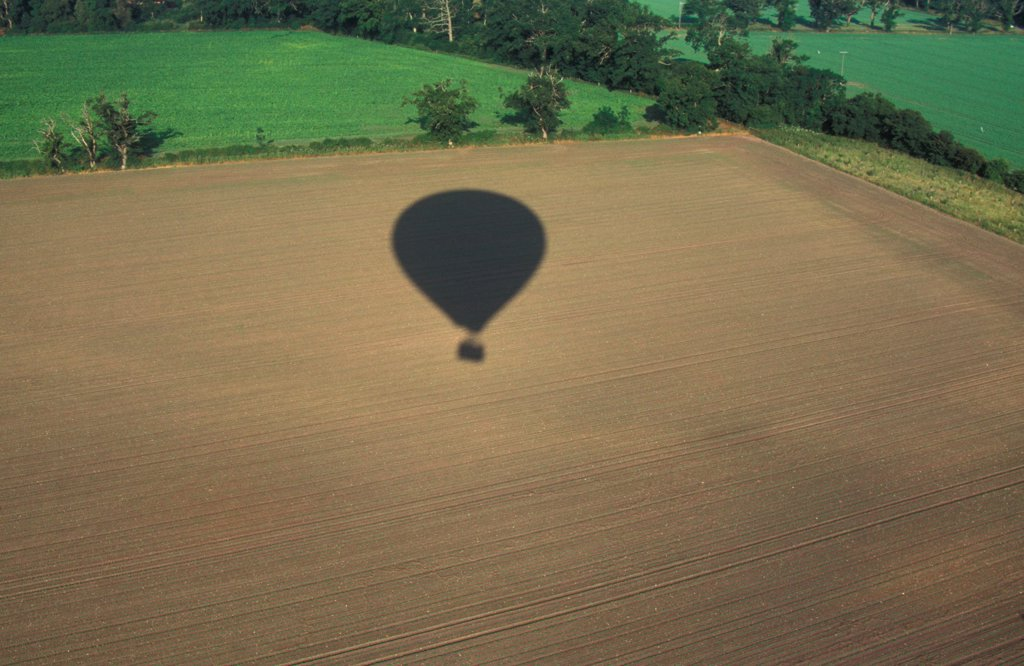 Stock Photo: 4421-41345 Sports & Pastimes Balloning -  Shadow of balloon over farmland