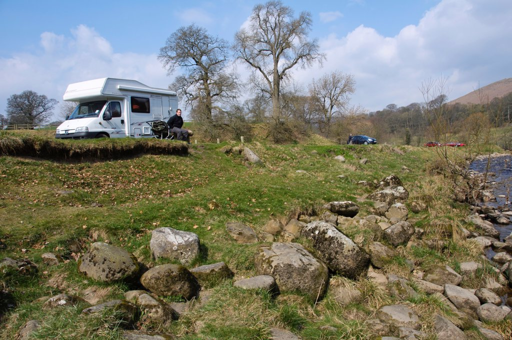 Motorhome and cars parked near riverbank, River Wharfe, Bolton Abbey, North Yorkshire, England, march : Stock Photo