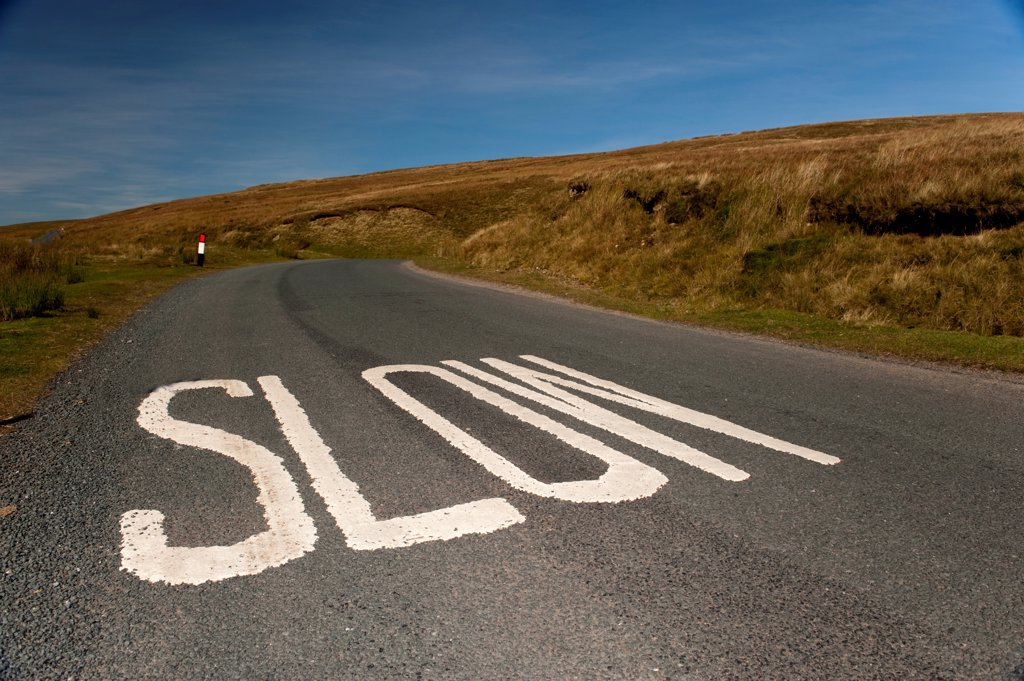 Stock Photo: 4421-41550 'Slow' marking on rural road, North Yorkshire, England