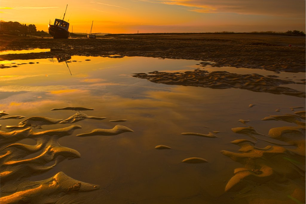 Stock Photo: 4421-42582 View of coastal creek at low tide during sunset, Burnham Overy Staithe, Norfolk, England, November