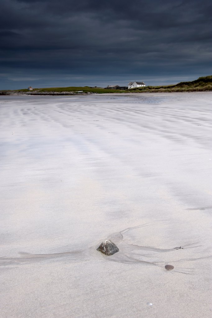 View of wave patterns on sandy beach and stormclouds, Salum, Isle of Tiree, Inner Hebrides, Scotland, August : Stock Photo