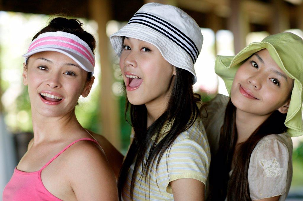Three young women smiling, Sabah, Malaysia : Stock Photo