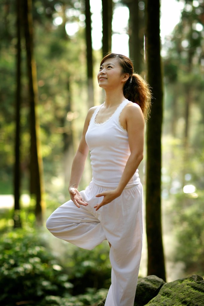 Young woman doing exercise, Beijing, China : Stock Photo