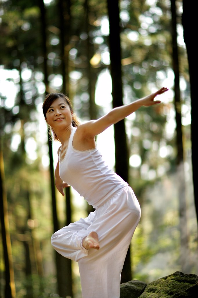 Stock Photo: 4422R-11865 Young woman doing exercise, Beijing, China