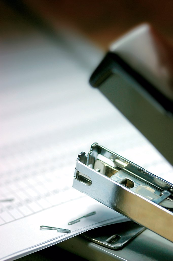 Black office hole punch with paper : Stock Photo