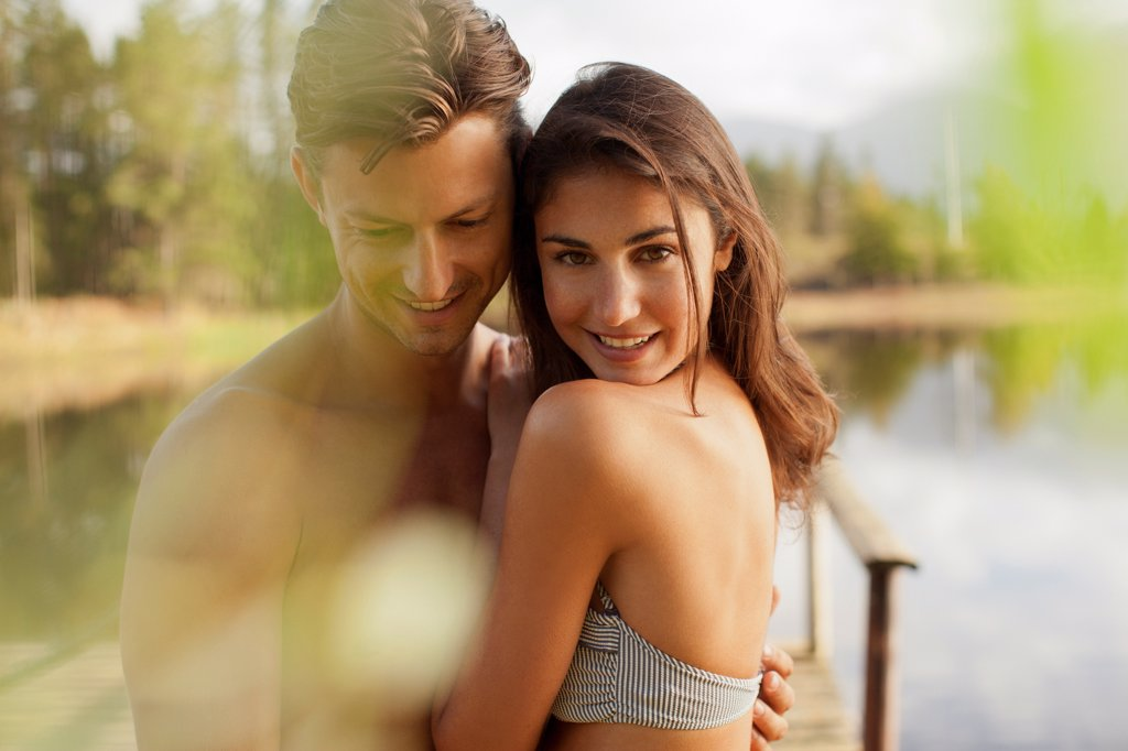 Cape Town, Portrait of smiling couple hugging at lakeside : Stock Photo