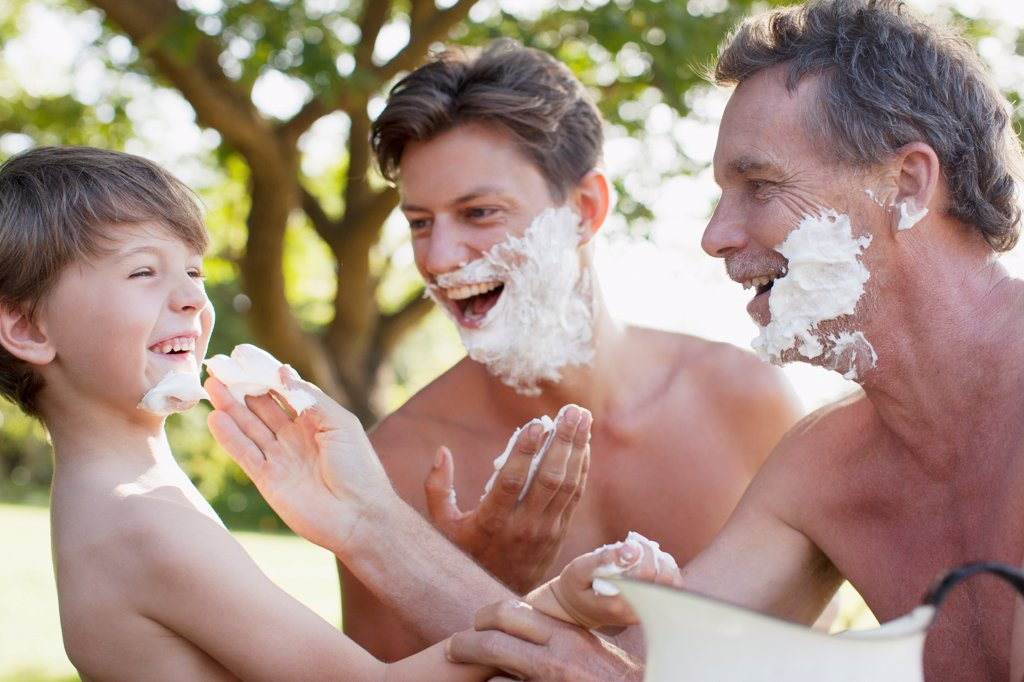 Cape Town, Playful multi-generation men applying shaving cream to faces : Stock Photo