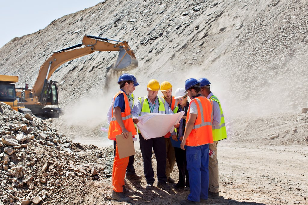 Stock Photo: 4428R-2760 Business people and workers talking in quarry, Spain