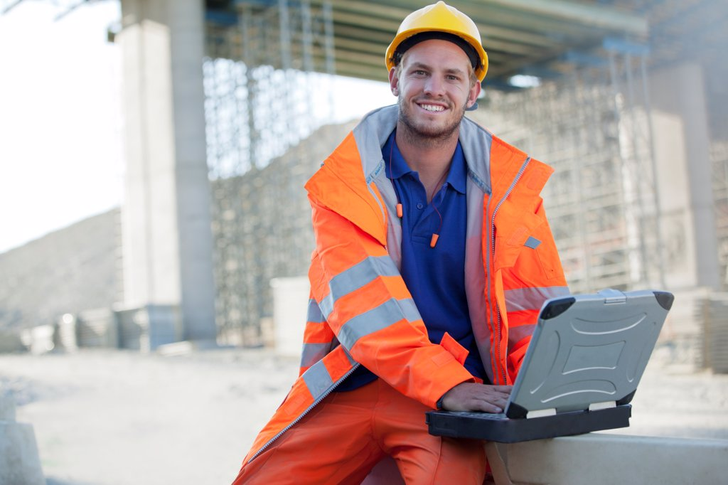 Stock Photo: 4428R-2780 Worker using laptop on site, Spain
