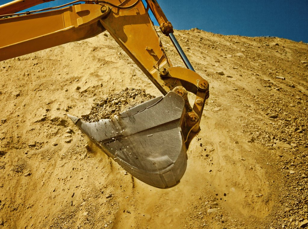 Digger working in quarry, Spain : Stock Photo