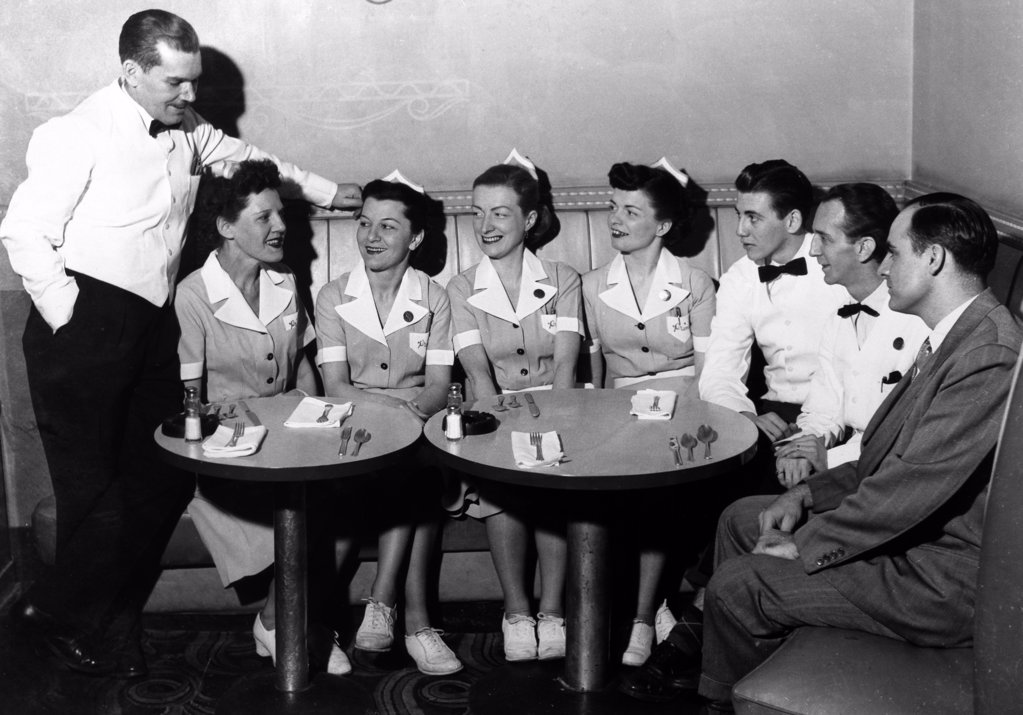 Group of people in a restaurant, 1940 : Stock Photo